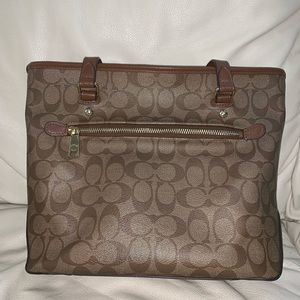Brown and gold Coach purse